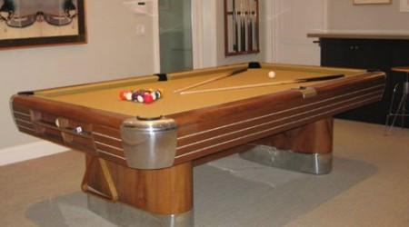 An antique Brunswick Anniversary pool table that has been fully restored by Billiard Restoration Service