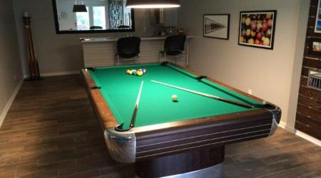 Restored Anniversary billiards table in pool room