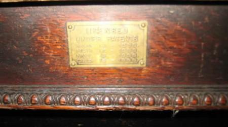 Closeup of billiard table patent plate
