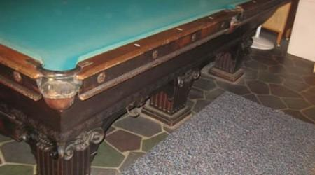 Before professional restoration, a Goodman-Leavitt-Yatter pool table