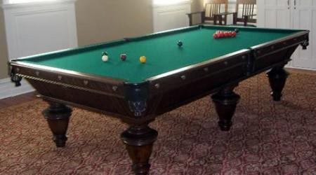 Fully restored International, an antique billiards table