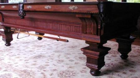 The Jewel, antique pool table with intricate carvings