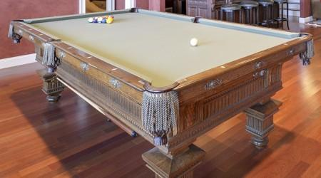 End view of a fully restored Jewel antique pool table
