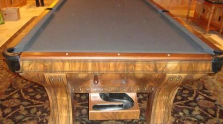 Restored antique Marquette billiards table