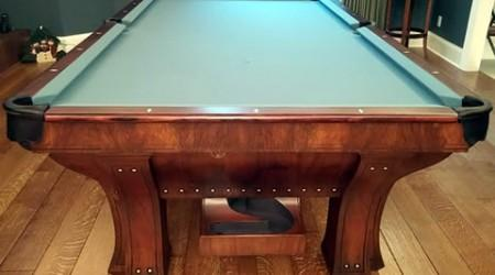 Corner pocket closeup of restored antique Marquette billiards table