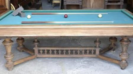 Prior to restoration, an antique pool table, The Marseille