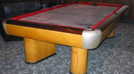 A restored Moderne, antique pool table by Brunswick