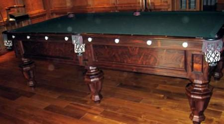 Antique, restored Phelan & Collender pool table with fretwork