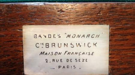 Brunswick's Bandes Monarch antique billiard table