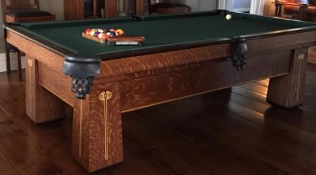 Fully restored antique Regina pool table positioned in a family home