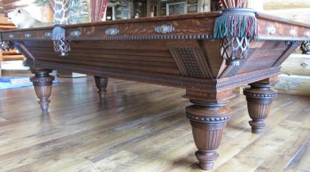 Corner view of restored antique Improved Union League billiards table