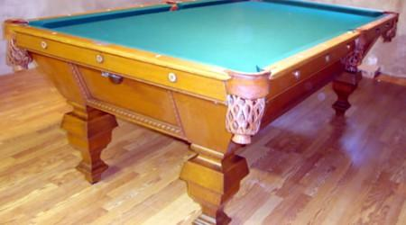 Restored antique billiards table with leather pockets, The Universal