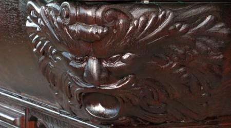 Detailed carvings of W.H. Griffith billiards table