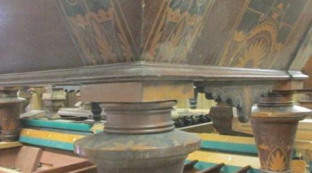 Leg of W.H. Griffith Inlaid billiards table before restoration