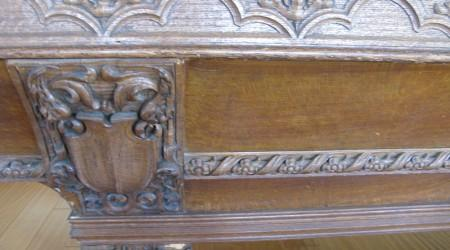 Before Restoration: Intricate carvings on Lockhart antique billiards table