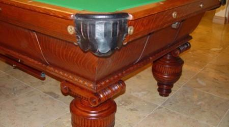 Corner pocket of antique Cambridge pool table