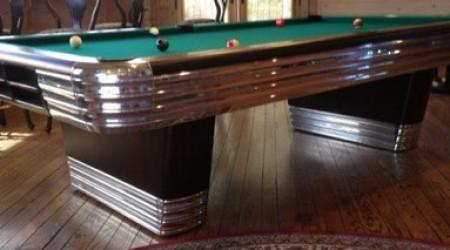 Restored Centennial billiards table in dark mahogany