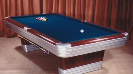 Lit display of antique Centennial billiards table