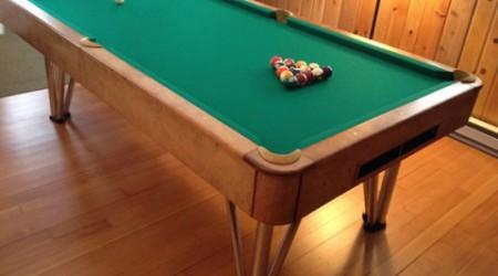 Post restoration process, an antique Champion Deco pool table