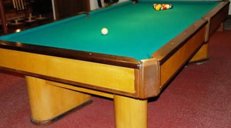 The Commander, a restored antique pool table