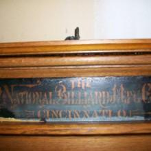 Top plaque: Mirrored Nationanal Cue Rack antique