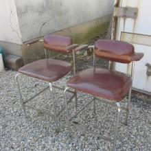 Front view of mid-century billiard chairs