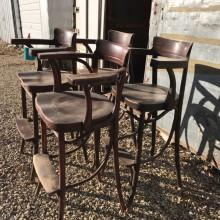 Side view of 4 antique Bentwood Billiard Chairs