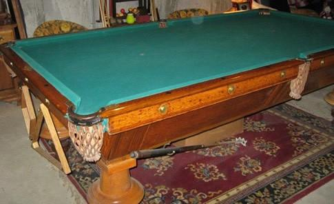 Antique pool table with upside down legs