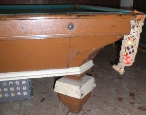 Closeup of damaged pool table