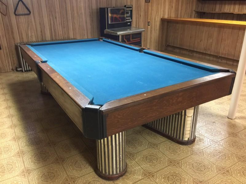 Damaged pool table with embellishments